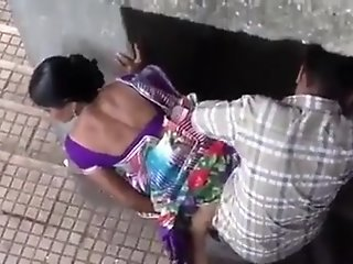 Surat pair underneath bridge..