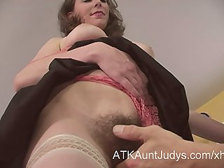 Hairy Milf seduces a younger..